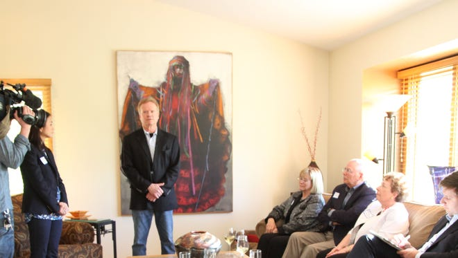 Potential presidential candidate Jim Webb addresses veterans at a private political event in Des Moines on Sunday.