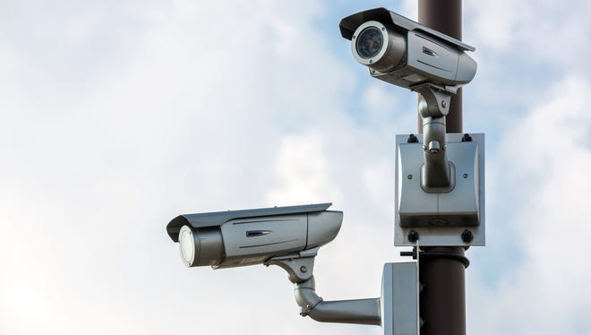 Stock image of roadside security cameras