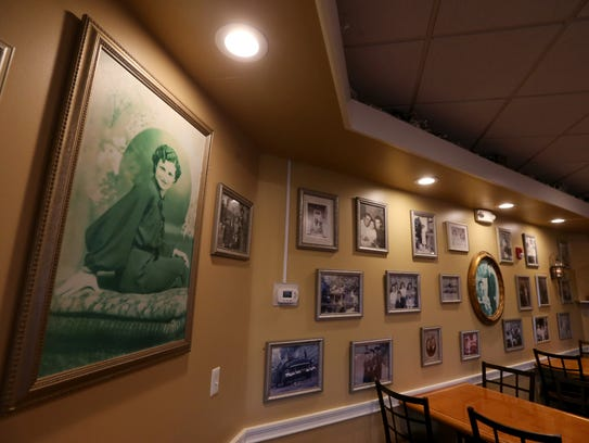 Family photos hang in the Colvin room at Red Fedele's