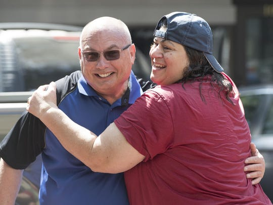 Visalia Mayor Steve Nelsen, left, gets a hug from a soaking wet Councilwoman Amy Shuklian immediately after her turn in the dunk tank Saturday on Main Street to benefit the American Cancer Society on Saturday, September 10, 2016.