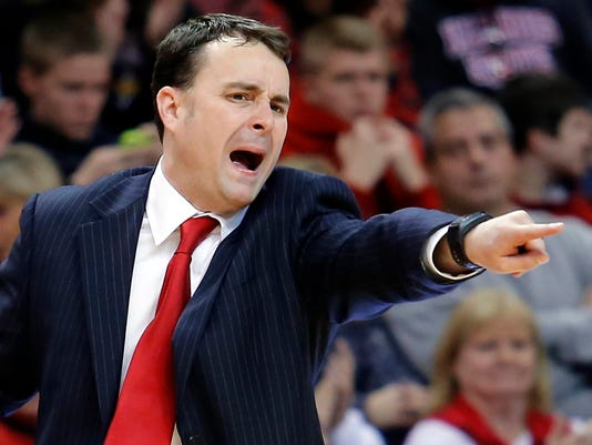 FILE - In this Dec. 7, 2013, file photo, Dayton coach Archie Miller calls out from the bench during an NCAA college basketball game against Illinois State in Normal, Ill.  Indiana has hired Miller as its new coach on Saturday, March 25, 2017. (AP Photo/ Stephen Haas, File)