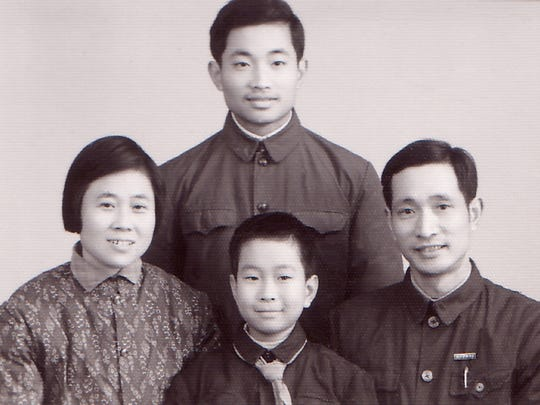 Ming Wang, at 16, is top and center in this family photo. Left to right are his mother, Alian; his younger brother, Ming-yu; and his father, Zhensheng.