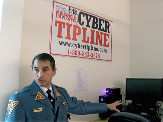 NJ State Police Lt. John Pizzuro, the commander of the NJ Regional Internet Crimes Against Children Task Force, shows the area Friday, January 12, 2018, at the State Police facility in Hamilton Township where cyber tipline calls are received.  The digital investigation unit he commands is key to the detection of pedophiles online and building cases against them.