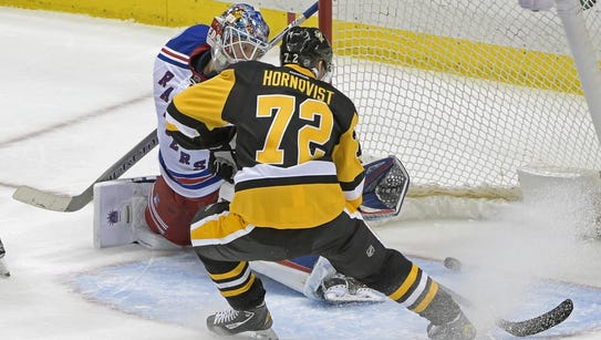 Pittsburgh Penguins right wing Patric Hornqvist slides