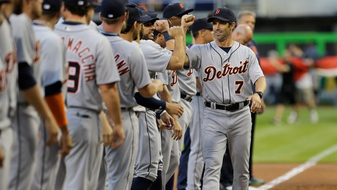 Detroit Tigers manager Brad Ausmus (7) greets his players during a ceremony before an interleague opening day baseball game between the Miami Marlins and the Detroit Tigers, Tuesday, April 5, 2016, in Miami.