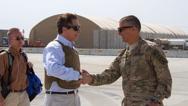 New York Gov. Andrew Cuomo is greeted by Regional Command-East Commander Maj. Gen. Stephen Townsend, right, at Bagram Airfield, Afghanistan, on Sunday. Four U.S. governors made a surprise visit to Afghanistan on Saturday as part of a delegation to receive counterterrorism briefings and greet troops stationed there. Cuomo, along with Gov. Brian Sandoval of Nevada, Gov. Bill Haslam of Tennessee and Gov. Jay Nixon of Missouri, traveled with officials from the U.S. Department of Defense, which sponsored the trip, Cuomo's office said.