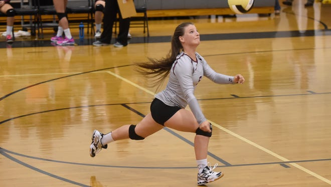 Stuarts Draft's Courtney Walton chases attempts to make a return during their volleyball game against Buffalo Gap on Tuesday, Sept. 22, 2015.