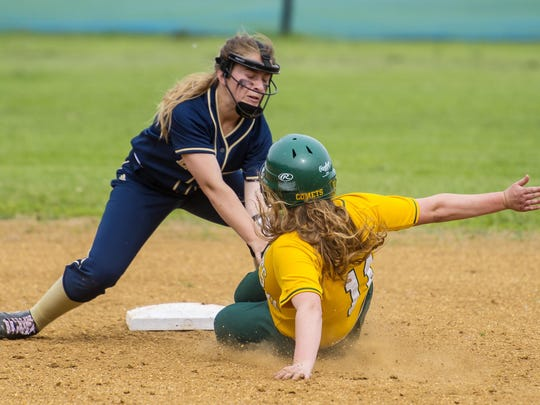 Essex's Emily Harvey, left, tags out BFA's Justina Lumbra as she tries to steal second in Essex Junction on Wednesday, June 10, 2015.