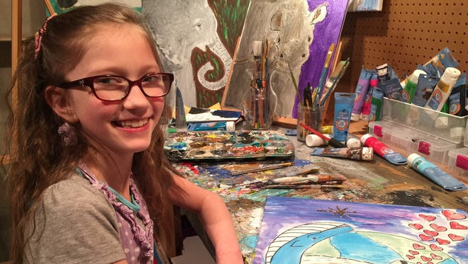 Artist Bria Neff, 9, creates paintings of endangered animals, which she sells to raise money to save them.