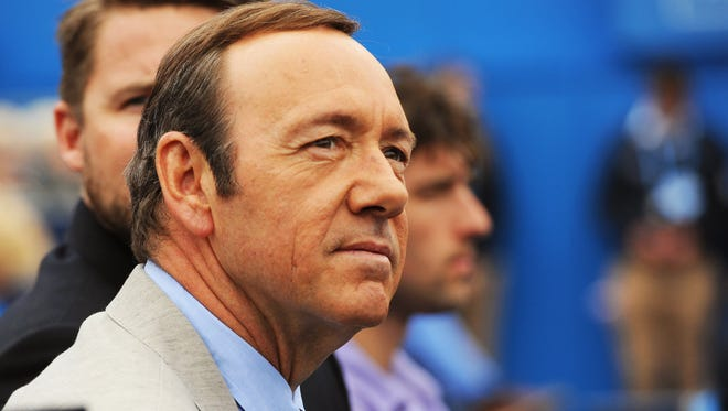 epa06297780 (FILE) - US actor Kevin Spacey watches a match during the Aegon Tennis Championships at the Queen's Club in London, Britain, 12 June 2013 (reissued 30 October 2017). In a statement posted on Twitter on 29 October 2017, Spacey has apologized to US actor Anthony Rapp, who had accused Spacey of acting sexually inappropriate towards him when he was 14. In the same post, Spacey said he chose 'now to live as a gay man'.  EPA-EFE/ANDY RAIN ORG XMIT: ARA3