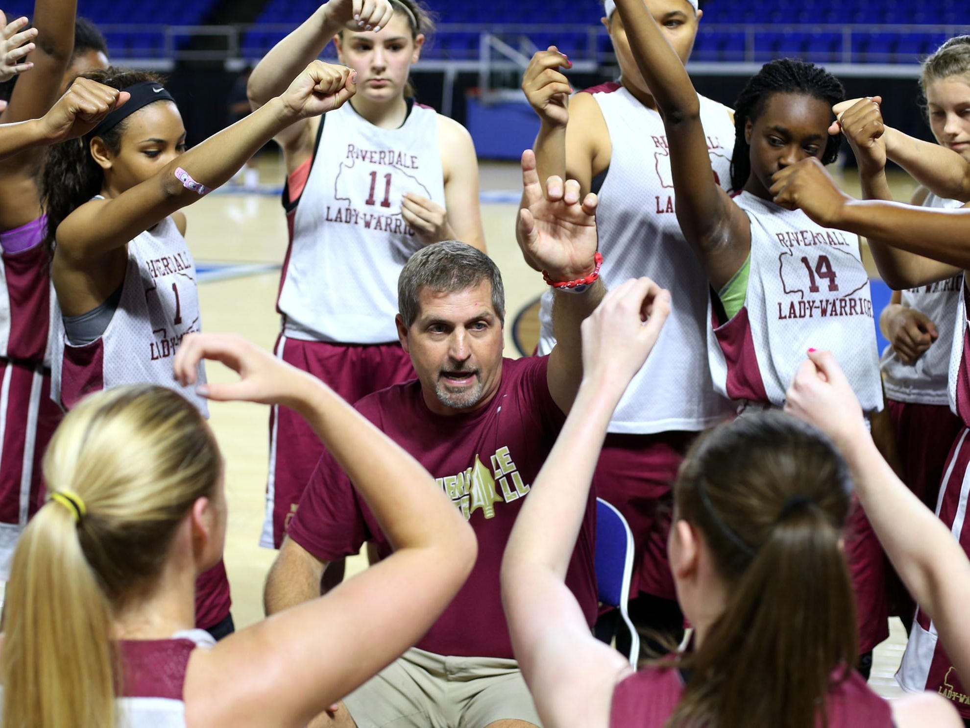 New Riverdale girls basketball coach Randy Coffman huddles with his team after a timeout at an MTSU team camp.