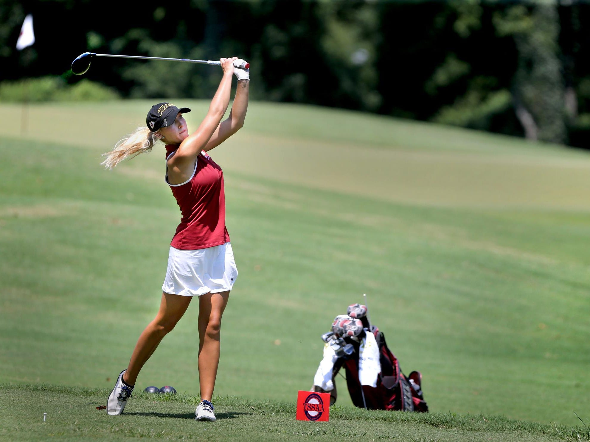 Riverdale's Reagan Kinnie watches her shot on the ninth hole at Stones River Country Club on Monday.