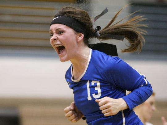 Chester County's Megan Bates (13) celebrates during the fifth set against Lexington at Chester County on Tuesday.