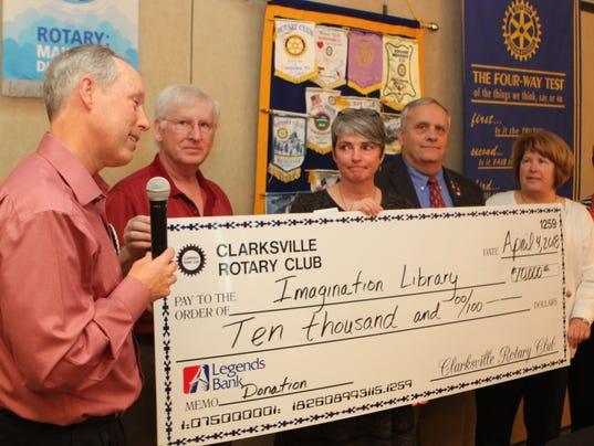 636585507254076293-Steve-Kemmer-Jim-Jay-Gary-Ginny-Newman-of-Clarksville-Rotary-Clubs-present-Martha-Hendricks-center-a-10-000-donation-check-for-Imagination-Library-36-.JPG