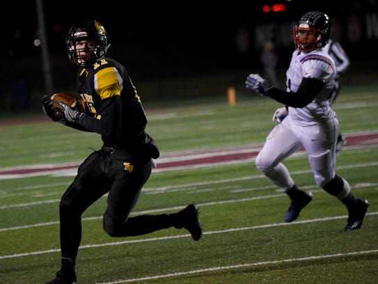 Tri-Valley's Jake McLoughlin hauls in a catch against Columbus Hartley.