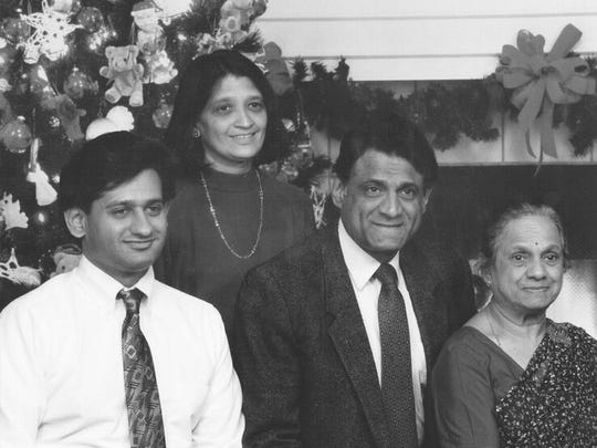 The author (center) with his son, Sandeep; wife, Asha; and mother Kusum.