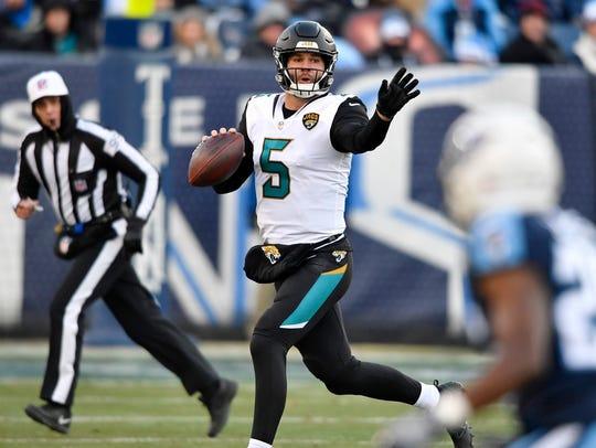 Jaguars quarterback Blake Bortles (5) signals to a