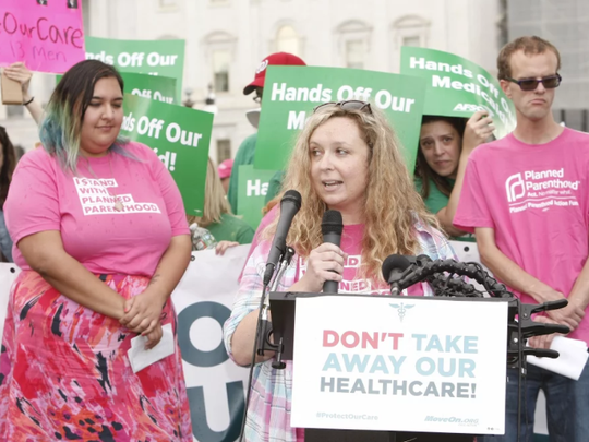 Amy Conkey of Reno speaks in June in Washington, D.C. at a rally against a GOP health care bill.