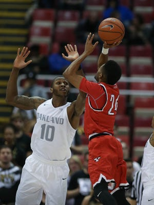 Oakland forward Isiah Brock defends against Youngstown State guard Cameron Morse during the first half of Oakland's 81-80 loss in the Horizon League tournament Saturday at Joe Louis Arena.