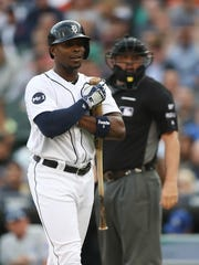 Tigers leftfielder Justin Upton strikes out during