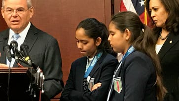 Sen. Bob Menendez criticizes Trump administration policy toward immigrants after hearing at a March 28, 2017 news conference about the arrest of the father of Fatima and Yuleni Avelica of California, as Sen. Kamela Harris, right, looks on.