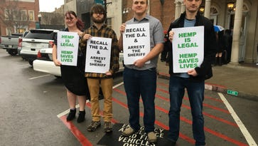 Group gathers to protest arrests of shop owners selling CBD