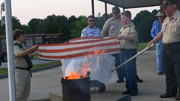 Residents turnout for first flag retirement at Veterans' Park in Tennessee Ridge