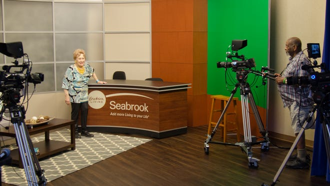 Residents Carole Barnhard and Glover Hill in Seabrook TV studio.