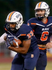 Blackman's Master Teague (33) takes the handoff from quarterback Connor Mitchell (6) during the game against Smyrna, on Friday, Sept. 8, 2017, at Blackman.
