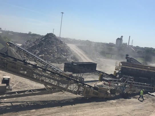 """A """"concrete crusher"""" is at work near I-696 in Macomb"""