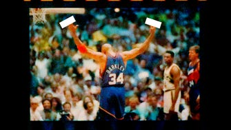 Phoenix Suns forward Charles Barkley eggs the crowd on while shooting free throws during Game 6 of the 1993 Western Conference Finals against the Seattle Supersonics. While motioning his arms up, he flipped off the crowd. He missed the first one but made the second.