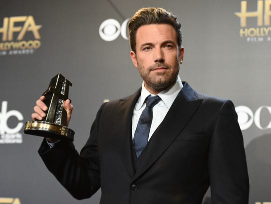 Ben Affleck poses in the press room with the Hollywood