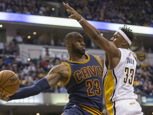 LeBron James passes around aggressive defense by Myles Turner, Cleveland Cavaliers at Indiana Pacers, Bankers Life Fieldhouse, Indianapolis, Wednesday, February 8, 2017. Indiana lost 117-132 to the reigning NBA Champions.