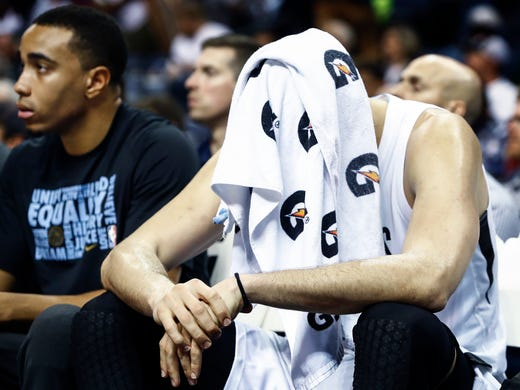 Memphis Grizzlies center Marc Gasol covers his head