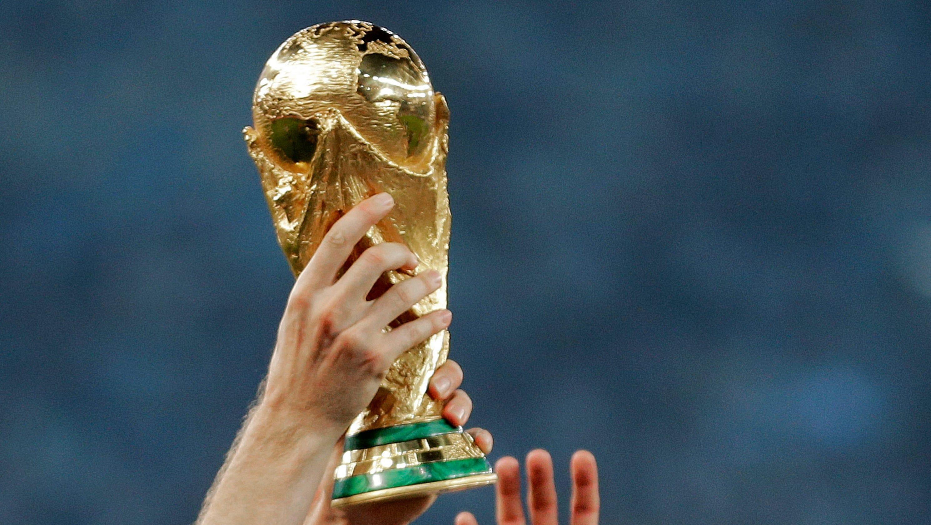 636570760174867518-ap-obit-wcup-trophy-designer-86387470