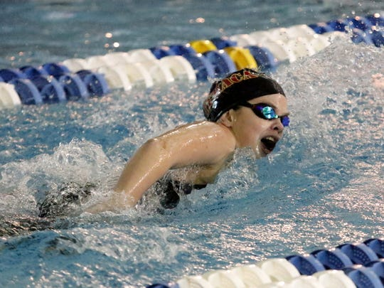 Annika Browning of Ithaca competes in the 200-yard freestyle preliminaries Friday at the state championship meet at Ithaca College.