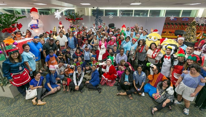 "United Airlines' Second Annual Fantasy Flight took 80 guests, including 23 children with Down Syndrome, on a flight to the ""North Pole"" on Dec. 3. This year's charity flight invited children and familes of the Down Syndrome Association of Guam."