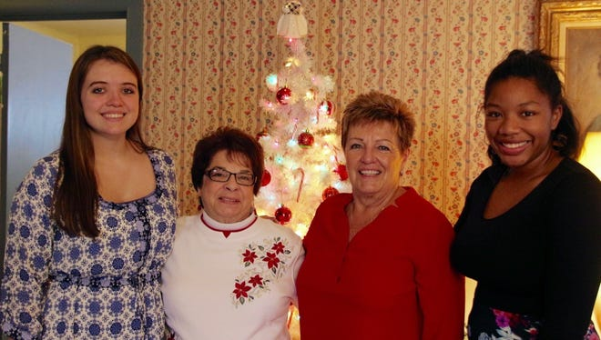 (From left) Lindsay Abbott of Port Norris, Pam McNamee, president, Millville Woman's Club, Sandy Walters, education chair, Millville Woman's Club, and Amaya Liles of Millville, are pictured at the club's holiday luncheon. Abbott and Liles, students at Millville High School, are the club's Girls Career Institute delegates.
