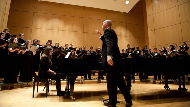 Jeff Goolsby directs Abilene Christian University choral singers. A group of 23 representing ACU will perform Monday at the Lincoln Center in New York City.
