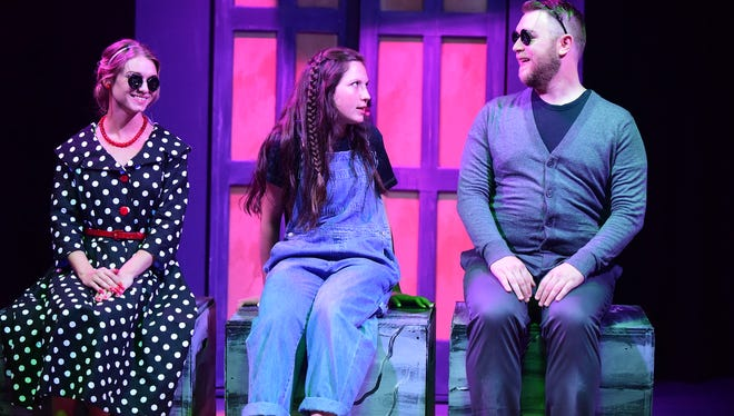 "Kendall Yorkey, Madeline McNichols (center) and Edward Lupella perform in ""Coraline,"" a musical adaptation of Neil Gaiman's tale."