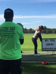 Alexis Jones practices on the driving range after Friday's