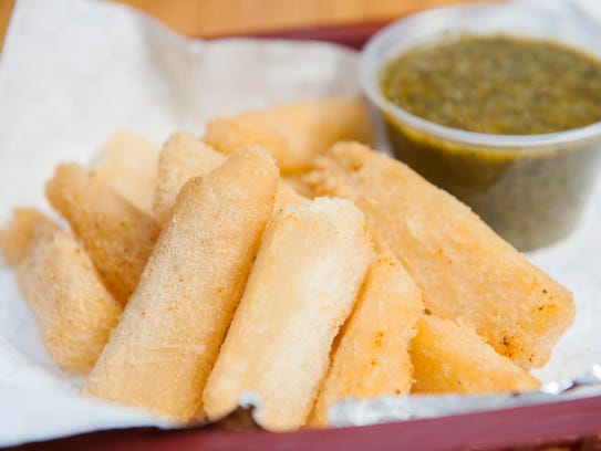 Yucca and chimichurri sauce at Andale' Latino Grill