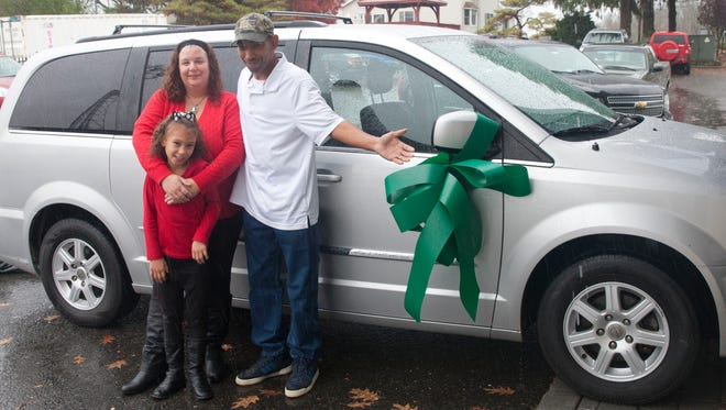 Recycled Rides donated a minivan to Irene Smith and Tyrone Thomas, Long Branch, and their daughter Alicia Thomas, 6, at Branning Collision Center in Freehold Township.