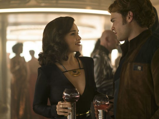 "Qi'ra (Emilia Clarke) reunites with her old sweetheart Han Solo (Alden Ehrenreich) in ""Solo: A Star Wars Story."""