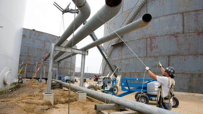 Don Sargable of APEX Piping Systems near Newport works on the Magellen Midstream project at Port of Wilmington in 2009. APEX acquired N. Barton & Associates of Prices Corner in a deal completed Dec. 31.