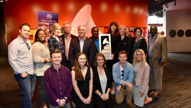 Students, faculty and friends of MTSU's College of Media and Entertainment surround President Sidney A. McPhee, who accepted a plaque that designates the university as the 10th member of the Grammy Museum's Educational Affiliate program.