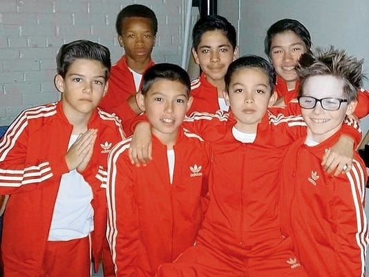 Courtesy photo The Showtime Jr. Shocka Lockaz also competed at the national championship and placed seventh. The team members are (front row) Jonathon Shaklee, Gabrial Stewart, Xsavio Sanchez, Grayson Benton; (back row) Rei' Shaun Spires, Alex Loya and Keanu Tran.