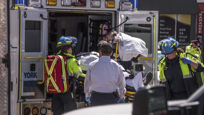 A injured person is put into the back of an ambulance in Toronto after a van mounted a sidewalk crashing into a crowd of pedestrians on Monday, April 23, 2018. The van apparently jumped a curb Monday in a busy intersection in Toronto and struck the pedestrians and fled the scene before it was found and the driver was taken into custody, Canadian police said.