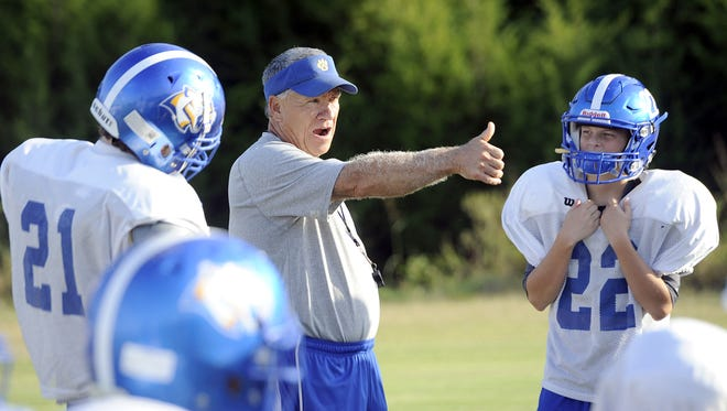 Goodpasture second-year head coach Jerry Joslin instructs his defense during Monday afternoon's practice.