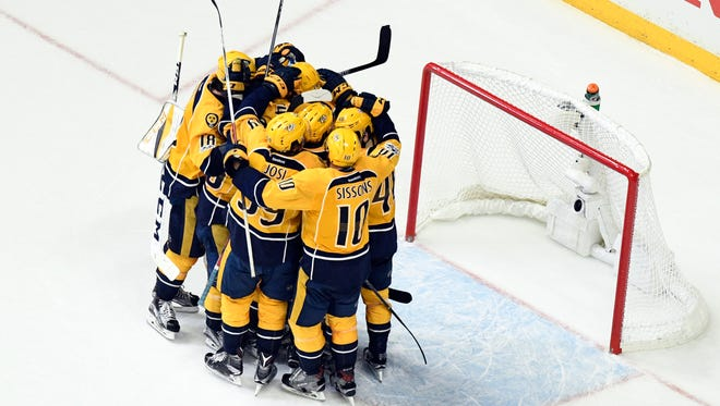 Nashville Predators players celebrate after a 6-3 win in Game 6 against the Anaheim Ducks that sent them to the Stanley Cup Final.